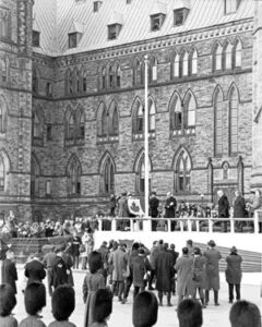 The red-and-white, maple leaf flag is raised for the first time on Parliament Hill